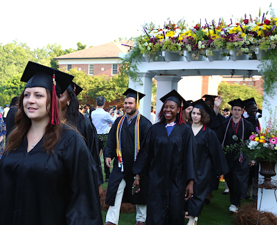 Students march into the graduation ceremony
